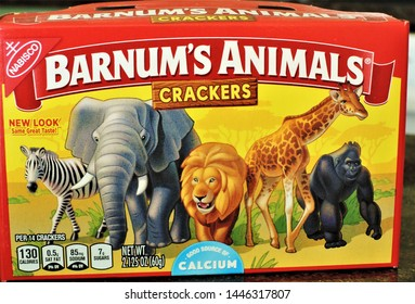 Denver, CO, USA. July 7, 2019. The redesigned Barnum's Animals Crackers box shows a zebra, elephant, lion, giraffe and gorilla wandering side-by-side in a grassland without a cage.