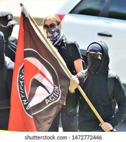 Denver, CO, USA. June 10 2017. Masked Antifa left-wing militant group protesting at a Trump rally in Denver.
