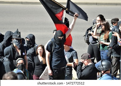 Denver, CO, USA. June 10 2017. Masked Antifa left-wing militant group protesting at a Trump rally in Denver.