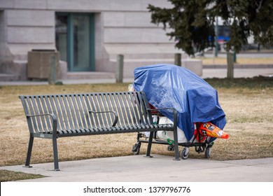 DENVER, CO, USA - MARCH 15, 2019: Homeless persons belongings in the park Downtown Denver Colorado image