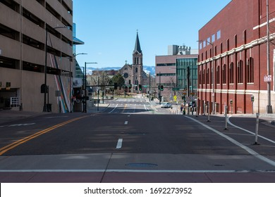 """Denver, CO/ USA- March 29,2020: Downtown Denver is a ghost town after the Governor issued a """"Stay at Home Order""""."""