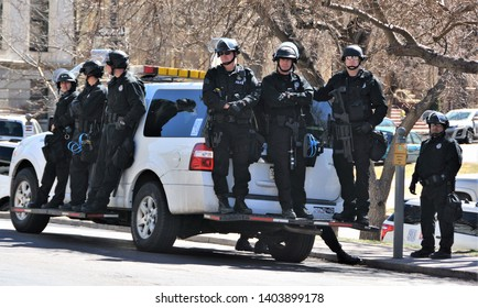 Denver, CO, USA. March 4, 2017. Police and SWOT officers standing by in riot gear in case they are needed at the Trump Rally in Denver to keep the peace.
