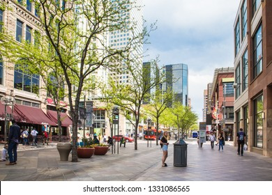 DENVER, COLORADO - APRIL 30. 2018: View of landmark 16th Street Mall, outdoor shopping district in the city of Denver Colorado with people visible.