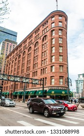 DENVER, COLORADO - APRIL 30. 2018: Street scene from the city of Denver Colorado with historic Brown Palace hotel and spa in view.