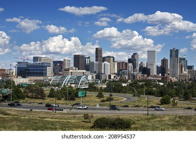 DENVER, COLORADO  AUG. 2, 2014: Denver skyline at Sunny Day. Denver is the capital of Colorado also has nicknamed the Mile-High City because the elevation is exactly one mile above sea level.