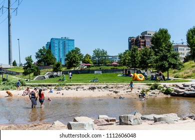DENVER, COLORADO - August 10, 2014: Tourism is a huge part of Denver's economy, with 11 record setting years in a row. This has made it a Mecca for outdoor recreation. The REI area is booming