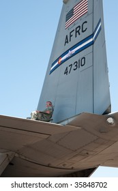 DENVER, COLORADO – AUGUST 22: Member of the military sits atop a C-130 getting a bird's eye view of the Jefferson County Air Show at Jefferson County Airport on August 22, 2009 in Denver.