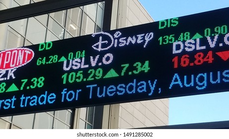 Denver, Colorado - August 27, 2019: LED stock tick display on a window