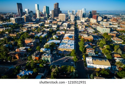 Denver Colorado Downtown Skyline aerial drone view of long perspective streets and roads in historic neighborhood in the Mile High City of Denver , Colorado