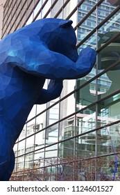 Denver, Colorado - February 18, 2018: famous blue bear peering into windows of the convention center
