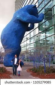 Denver, Colorado - February 23, 2018: iconic blue bear at convention center peeking through window