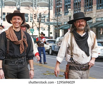 Denver, Colorado - January 10, 2019: Two men dressed as outlaws and walking in the annual Western Stock Show parade