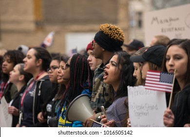 Denver, Colorado - January 20, 2017:  Hundreds of people march through downtown in protest of Trumps inauguration that day.