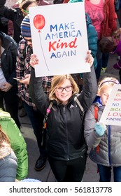 DENVER, COLORADO - JANUARY 21 2017: A girl holds a sign in a 200,000 strong protest in downtown Denver in the Women's March on January 21st 2017, one day after President Trump's inauguration.