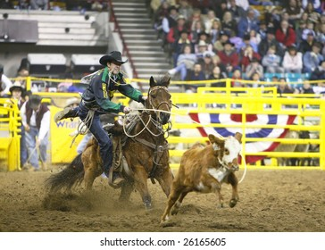 DENVER, COLORADO - JANUARY 25: Top-ranked PRCA Tie Down Roper, Josh Peek of Colorado, wins the prestigious National Western Stock Show's championship round and Tie Down Roping Title on Jan. 25, 2009 in Denver, Colorado.