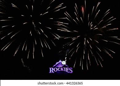 DENVER, COLORADO - July 3, 2015 - Fireworks over Colorado Rockies neon marquis