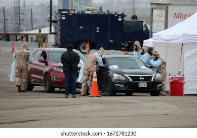 DENVER, COLORADO - MARCH 14, 2020: People come to the Coronavirus testing site at Denver Coliseum