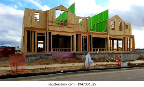 Denver, Colorado - March 23, 2019: a new wooden townhome being built