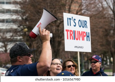 Denver, Colorado - March 25, 2017: A few dozen Trump supporters gathered for the Make American Great Again March.  Separated by police, Trump supporters and protesters exchanged words during the rally