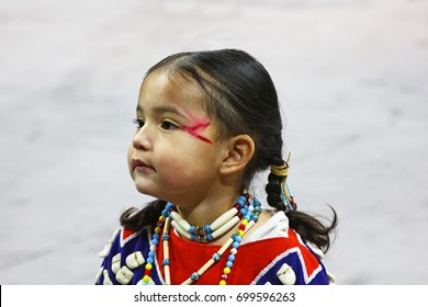 DENVER, COLORADO - March 26, 2017 - Closeup of young native American girl in makeup and costume