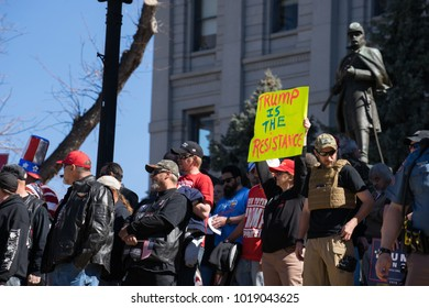 Denver, Colorado - March 5 2017: Supporters of President Trump hold the March 4 Trump at the State Capital.  The actual march was canceled due to security concerns generated by protesters.