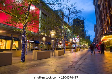 DENVER, COLORADO - MAY 1, 2018:  Street scene along the 16th Street Mall in downtown Denver Colorado at night with lights and people in view