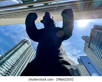 Denver, Colorado - May 27, 2021: Blue Bear leaning on the windows of the Denver Convention Center in Denver, Colorado