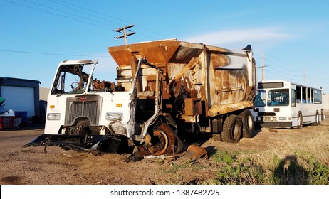 Denver, Colorado - May 3, 2019: Burnt Peterbilt Dumpster Truck