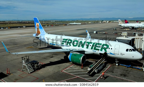 Denver, Colorado - May 6, 2018: Frontier Airlines Airbus A320neo parked at gate A38 in Denver International Airport.