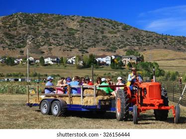 DENVER, COLORADO - October 10, 2015 - Families on a hayride at a fall festival