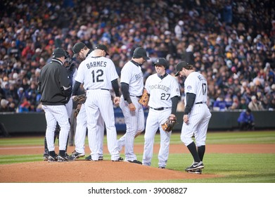 DENVER, COLORADO - OCTOBER 11:  The Rockies infield listens to manager Joe Tracy in game 3 of the Rockies, Phillies National League Division Series on October 11, 2009 in Denver Colorado.
