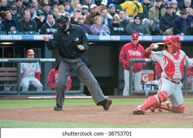 DENVER, COLORADO - OCTOBER 12: Home plate umpire calls strike three in game 4 of the Colorado Rockies, Philadelphia Phillies series on October 12, 2009 in Denver Colorado.