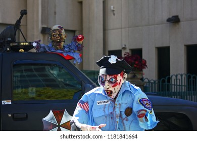 Denver, Colorado - October 17, 2017: Person dressed as police office during annual zombie crawl