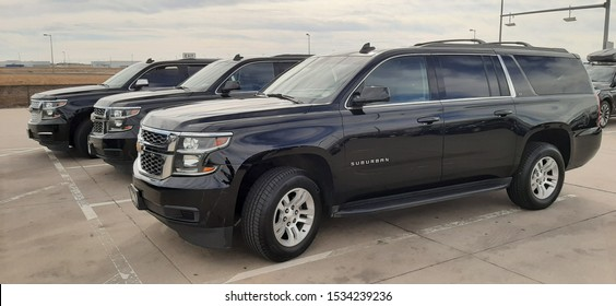 Denver, Colorado - October 17, 2019: Black Chevrolet Suburban SUVs parked in the Commercial Holding Lot at Denver International Airport