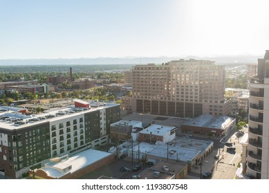 DENVER, COLORADO - SEPTEMBER 17, 2018: Commercial office buildings and corporate businesses in downtown Denver, Colorado during a beautiful sunset.