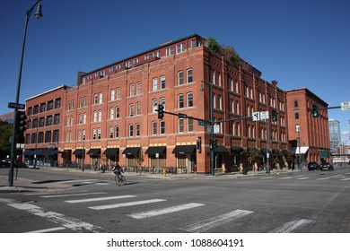 DENVER, COLORADO – SEPTEMBER 30: Lone bicycle rider in the LoDo historic district on September 30, 2009 in Denver, Colorado. The Lower Downtown Historic District is one of the oldest city settlements.