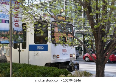Denver, Colorado, United States - April 26, 2018: Public transportation seen passing by through streets of Denver during spring.