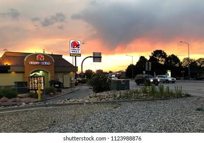 Denver, Colorado / United States -  June 29, 2018:  Taco Bell fast food franchise at dusk