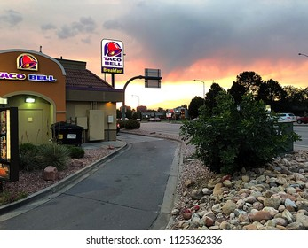 Denver, Colorado / United States - June 28, 2018:  Taco Bell drive thru at dusk