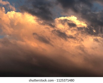Denver, Colorado / United States - June 28, 2018:  Majestic clouds at twilight with reflections of the angle of the sun
