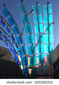 Denver, Colorado, USA - 11 November 2017: Glass art installation in the parking lot next to the Denver Zoo. Sun shining through modern blue and green glass art installation at the Denver Zoo.