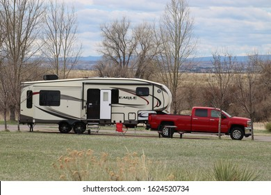 Denver, Colorado, USA - April 10, 2016.  A fifth wheel camper and truck begin their set up at Cherry Creek State Park in Denver.  Situated in Denver, it's a nature preserve that attracts many visitors