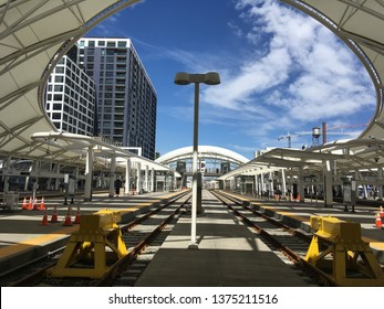Denver, Colorado / USA - April 15, 2019:  Rail road tracks at Denver Union Station and urban buildings