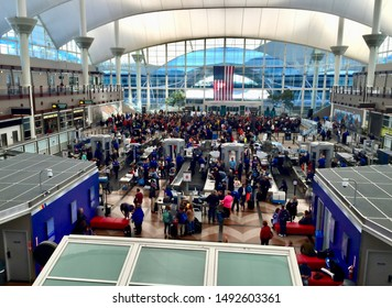 Denver, Colorado / USA - January 1, 2016: People crowd a TSA security screening area at Denver International Airport on New Year's Day.