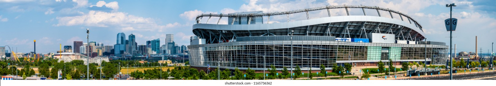 Denver Colorado USA July 22, 2018 A panoramic photograph of the NFL Denver Broncos stadium at Mile High with the downtown area of Denever in the background