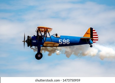 DENVER, COLORADO / USA - July 27, 2019: World War II era military airplanes on display and flying at the 2019 WarBird Auto Classic, a showcase event at the Colorado Air and Space Port.