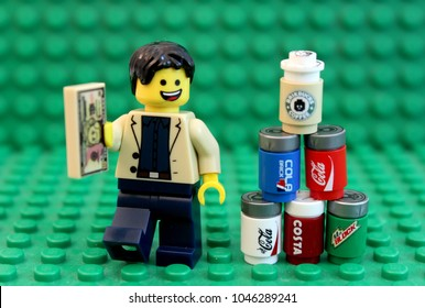 Denver, Colorado, USA - March 9, 2018: Studio shot of Lego style cans of cola and other drinks.