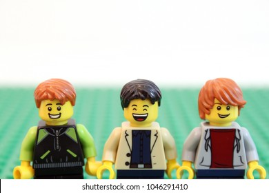Denver, Colorado, USA - March 9, 2018: Studio shot of Lego minifigure guys smiling and happy.