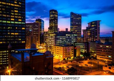 Denver , Colorado , USA - Nightscape sunset blue hour cityscape skyline of the Mile High City along the Rocky Mountain Front Range. City lights illuminated the city streets towers and skyscrapers