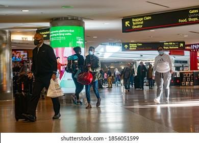 Denver, Colorado, USA - November, 5, 2020: People wearing mask in Denver International airport during covid-19 pandemic.